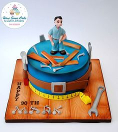 Handyman carpenter cake - For all your cake decorating supplies, please visit craftcompany.co.uk