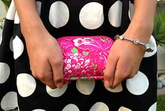 Lilly Pulitzer clutch, dotted dress, and a jeweled silver bangle.