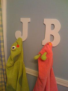 Towel Racks - easy to DIY with letters from Hobby Lobby and pegs from Home Depot (I'm actually thinking this might be good for the mudroom for jackets and backpacks)
