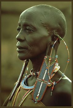 This photograph contains an image of a Maasai women. She is adorned in beautiful beadwork and jewelry, that is known to be a symbol of wealth. The Maasai are a semi-nomadic group that makes their home in Kenya. Cultures Du Monde, World Cultures, African Tribes, African Women, African Image, Black Is Beautiful, Beautiful People, Arte Tribal, Tribal People