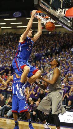 Kansas center Jeff Withey dunks over Kansas State forward Jordan Henriquez during the second half