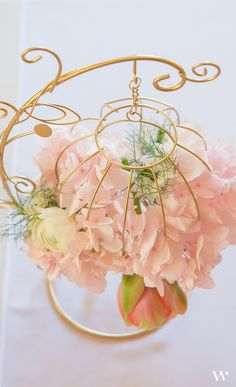 These ornamental wire decorations are the perfect starting point for a wide range of distinctive centrepieces. With the addition of pretty, pink,  fresh flowers and gold paint, these are a stunning addition to table decor.