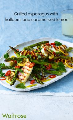 Grilled asparagus with halloumi, caramelised lemon and chopped chillies for fresh summer dish. Check out the Waitrose website for even more delicious recipes.