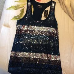 Express Sequin Tank Top This is a really cute sequin top, as shown in the second picture there's lace over sections of sequins. New and no flaws in a size xsmall that's why it looks big on me Express Tops Tank Tops