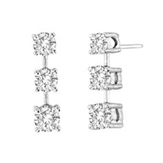 Bold and brilliant, these diamond drop earrings are a sparkling look, perfect for that special evening out. Crafted in cool 14K white gold, each earring features three shimmering prong-set diamonds bridged together by polished bars to create this glittering linear look. Radiant with 1-3/8 cts. t.w. of diamonds and polished to a brilliant shine, these post earrings secure comfortably with friction backs.