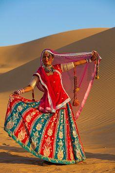 Dancer posing on the dunes of the , Thar Desert, Jaiselmer, Rajasthan, India