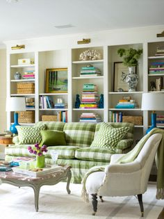 Wall to wall bookcase styled with color and texture