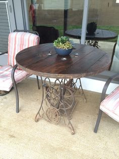 Patio table. Wire reel stained and sealed on top of an old singer sewing machine stand.
