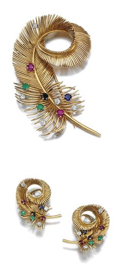 GEM-SET AND DIAMOND DEMI-PARURE, BOUCHERON, 1950S.  Comprising: a brooch designed as a stylised feather, set at intervals with circular-cut rubies, sapphires, emeralds and diamonds, signed Boucheron Made in France, French assay and maker's marks, British import marks for London, 1952; the ear clips, unsigned.