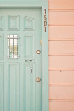 Mint green door and peach wall....LOVE.  Maybe I can have a little guest house or storage building in these colors someday.