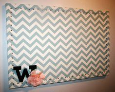 Fabric covered cork board with nail head trim.. Use cheap cork board from hobby lobby. Use patriotic colors.