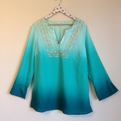 Embellished Ombré Blouse Size: 16W Brand:  Metro 7 Fit: No stretch  Sleeves:  3/4th sleeve  Material:  100% polyester  Color: Blue and gold   Other details: Floral embellished neckline, gold threads and  sequins. Ombre. Vneck, semi sheer  Condition: Pre loved.  MSRP $36.00  Measurements are available upon request. No model swaps or holds. Please read my bio before purchasing or commenting. Metro 7 Tops Blouses