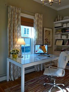 This could be it....love the window treatment, desk in front of window, simple desktop, crown moulding.  Love the feel of this room.  Paint blue?
