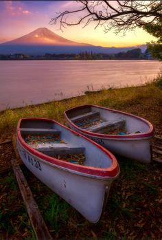 Abandoned boats with Mt.Fuji. Sunset scene of Mountain Fuji with abandoned boats in foreground at Lake Kawaguchiko, Japan. Photo by Jirawat Plekhongthu. Source Flickr.com