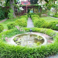 A series of spheres supplies structure to a minimalist water feature. A gravel path from the house ends at a gently bubbling pond. Plants echo the shape of hardscape. Here, liriope encircles the small pond. Repetition is a key design element to this water landscape; multiple circles tie everything together. The continuation of the path around the pond maintains circulation through the garden. In place of a stationary pool of water, a bubbling base in the pool offers water movement./
