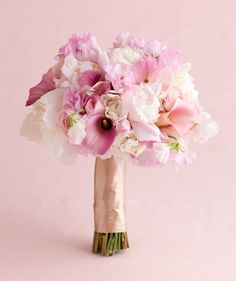 Pink Wedding Flowers  Pink Peony and Sweet Pea Mix  Peonies, calla lilies, ranunculus, and sweet peas in varying shades of pink create a distinctly feminine arrangement.  Bouquet by Chestnuts in the Tuileries
