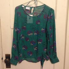Green flowered sheer blouse Brand new with tags.  A beautiful sheer green blouse with flower pattern. Button closure In back. The blouse is a size small.  Open to offers.  From a smoke free home thank you for looking! Jaclyn Smith Tops Blouses