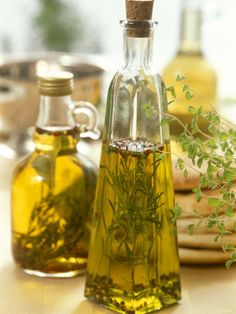 Oil with Herbs and Spices in Two Bottles Lámina fotográfica por Alena Hrbkova en AllPosters.es
