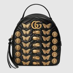 64d7084945 GG Marmont animal studs leather backpack - black leather by Gucci. Oasis  High Fashion Handbags