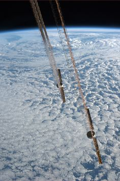 As we fly perpendicular to the terminator, we get an edge-on view of our Space Station's solar arrays.  Taken September 18, 2013.  KN from space.
