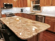 Fresh Typhoon Bordeaux Granite with Cream Cabinets