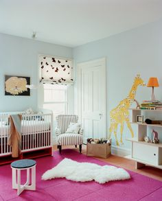 Pink is employed in a fresh way for a nursery floor. Photo by Max Kim-Bee.