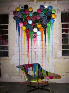 creative coloring: dripping paint cans forming a heart on the wall