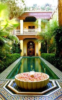 Indian/Arabic swimming pool. Absolutely stunning. The tiling would have taken ages!