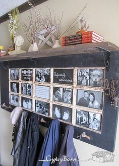 old glass paneled door, hung horizontally and used as picture frames, coat hooks, and mantel above.