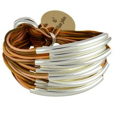 Gillian Julius Mixed Cord Multi Tube Bracelet, Silver   Rust Mix Cord. Multi strand bracelet consisting of 20 waxed cotton cords that fade in and out of the rust colored spectrum. Each cord of bracelet features a silver tube.