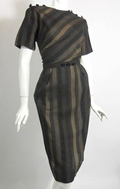 60s grey, charcoal and coffee striped cotton dress with angled stripe bodice, vertical on skirt. Button accents on shoulders picked up by belt, buckling in back.180