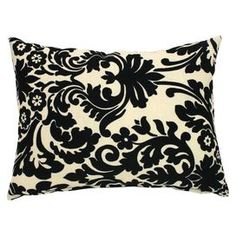 "Indoor/outdoor boudoir pillow with a damask motif.  Product: Boudoir pillow   Construction Material: Sunbrella fabric and polyester insert   Color: Black and white   Features:  All-weather resistant fabricPlush, comfortable fillFlowing damask motif on front and solid black reverseInsert included   Dimensions: 12"" x 16""       Cleaning and Care: Spot clean with baby wipes. Machine washable. Air dry only."