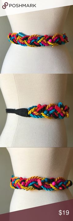 """Vintage Multi Color Rope Wooden Bead Stretch Belt Vintage nylon braided cord and wooden bead stretch belt. Fishhook back clasp. The black ends of the belt are elastic cord so there is another 1-2"""" of stretch. Last pic shows length when belt is relaxed. In great vintage condition. Vintage Accessories Belts"""