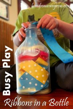 Here is an easy, no frills fine motor activity for toddlers.  They can do it independently while you get dinner on the table; or you can practice early learning concepts together (put in all the red ribbons, put in three ribbons, find the longest ribbon...)