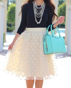 Polka Dot Tulle Skirt and Navy top with Pearl Necklaces and Kate Spade Purse  #PolkaDotsSkirt #LadiesSkirt #PearlNecklace #LeatherHandBag #FashionTrend #FashionStyle #StreetStyle