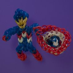 Learn how to make a Captain America action figure and shield with Rainbow Loom as part of the Learning Express toys Superhero Rainbow Loom Club! Watch the video and find other designs on our Rainbow Loom Headquarters! Loom Love, Fun Loom, Rainbow Loom Tutorials, Rainbow Loom Creations, Rubber Band Charms, Rubber Bands, Crafts For Teens, Diy For Kids, Rainbow Loom Characters