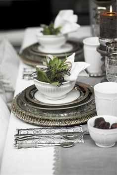 A Place at the Table * Elegant silver charger and silver edged dishes with a white complimentary dish that holds a organic place setting decoration.