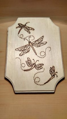 Items similar to Wood burned, dragonflies plaque on Etsy,Items similar to Wood burned, dragonflies plaque on Etsy What's wood burning ? The tree burnt by treatment approach by transferring an image on wood i. Wood Burning Tips, Wood Burning Techniques, Wood Burning Crafts, Wood Burning Patterns, Wood Patterns, Wood Crafts, Wood Burning Projects, Wood Burning Stencils, Stencil Wood