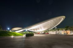 influenced by the rapidly developing car automation systems, the swooping 'ausfahrt roof and service pavilion' by german firm graft offers guests the opportunity to experience these state-of-the-art automotive technologies first hand.