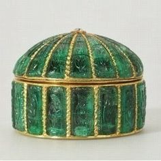 Carved emerald circular box. Mughal India circa 1635. An identical cypress is carved on each panel.