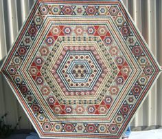 """Linda White - This is my 'Dear Prudence' Quilt that I made using 5/16"""" hexagons....17,977 in total. I am currently working on a new design using 1/4"""" papers."""