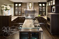 like: dark wood tone, light countertops  dislike: cabinet face too plain, and glass island (looks neat, but not practical for us)
