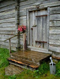 Humble Log cabin porch, Dalarna, Sweden.