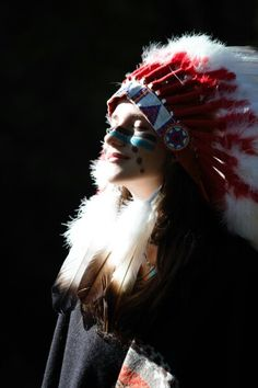 Native. Happy. Smile. American. Chickasaw. Feathers. Indian. Face paint. Love. Spirit.  Sun. Wolves. Necklace. Photography. Photo. The people. Blue. Headdress