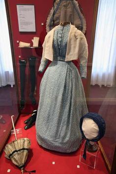 Clothes and accessories worn by Charlotte Bronte on display in her old bedroom at the Bronte Parsonage Museum