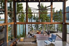 Base Camp is a mountain retreat designed for family living by Johnston Architects, nestled high above Lake Cle Elum in the Cascade Mountains, Washington.