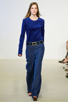 Calvin Klein. I'm not sure anyone can pull off those pants off the runway, but I covet that top--it's suede, and such a rich blue.