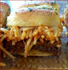 Spaghetti and Meatball Sliders, for an appetizer or a meal, these little hand held sandwiches have all the flavors of a spaghetti and meatball dinner | Recipe developed by www.BakingInATornado.com | #recipe #appetizer #sliders