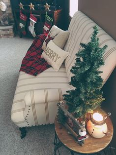 Christmas Home Tour on www.sugarmaplenotes.com - Christmas decor, pillows & plaid blankets, small couch, home, holiday decorations