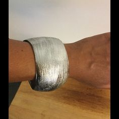 "Gorgeous metal bangle Closing my closet for vacation on Sunday. Last chance to grab this beauty in time for fireworks!!!    2 1/4""H, 2 5/8""D silver brushed metal bangle, brand new in package! Perfect for the beach, or a night on the town. Farah Jewelry Jewelry Bracelets"
